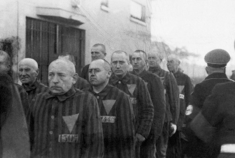 Concentration camp prisoners wearing the pink triangle